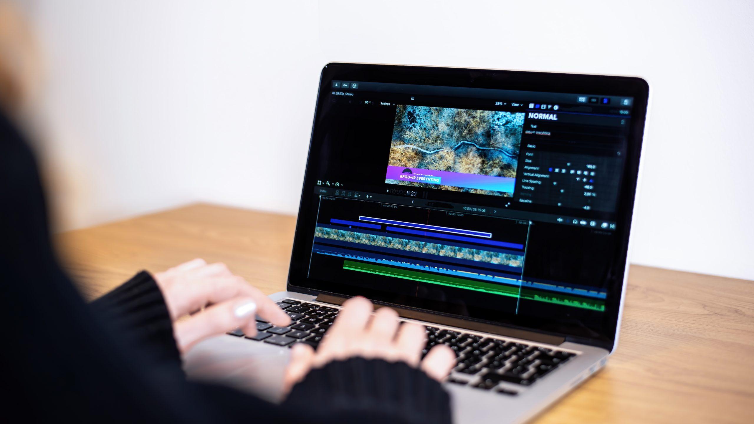 young content creator girl editing video her laptop working from home scaled - برنامج تعديل الفيديو بدون علامة مائية للكمبيوتر 5 برامج احترافية